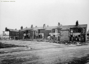 A photograph of the run down streets of Ardwick, 1930.