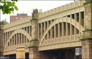 A bridge over the River Tyne which was designed by Robert Stephenson, 1849.
