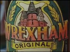 The famous Wrexham Lager, a symbol of Hughes's hometown - http://news.bbc.co.uk/local/northeastwales/hi/people_and_places/history/newsid_8519000/8519912.stm