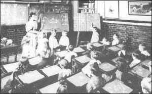Victorian school children. Minnie would have taught how to read and write in a school environment similar to this.