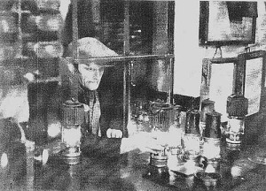 The Overman preparing the safety lamps for the miners