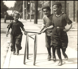 Young boys playing with hoops, 1922.