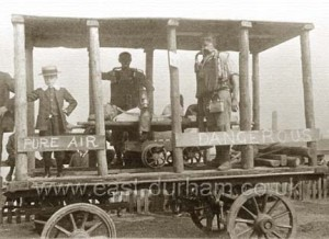 Mine Rescue float showing what looks like mining rail stretcher, miners lamp and breathing apparatus. Flauss? Float heading for Seaham Flower Show 1910