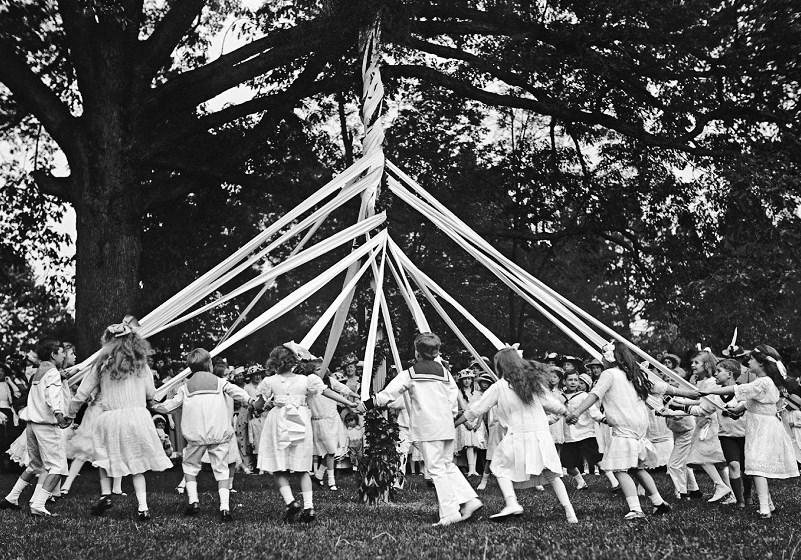 Children celebrating May Day Maypole Dancing in the nineteenth century