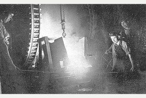 A dramatic study of a furnace being tapped at Shotton Bros LTD