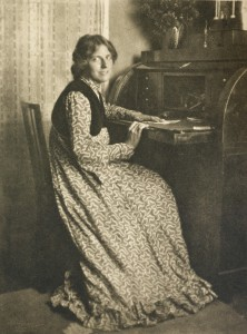 Woman at a writing desk -1900