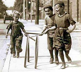 An example of what playing with hoops as a child in the early 20th century looked like.